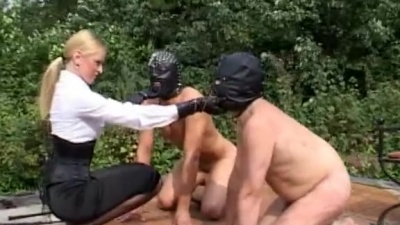 Femdom spanking & using masked subs as foot stools outside