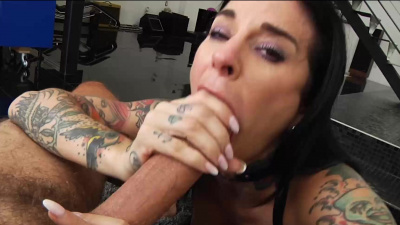 Tattooed Joanna Angel sucks a hefty cock and masturbates