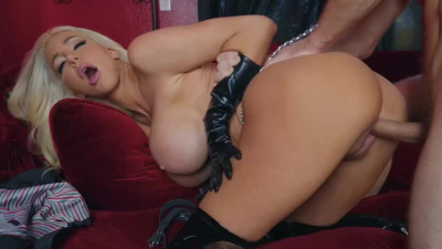 Blonde Nicolette Shea in latex with big fake tits does blow job and gets fucked