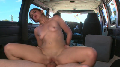 Young redhead Adriana fucks a guy in the car for money