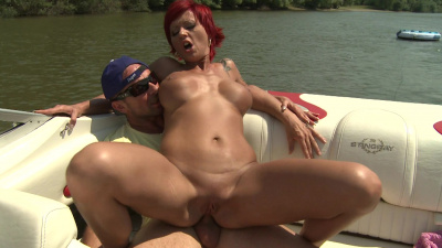 Redhead Patricia Gold gets her ass stuffed on the boat